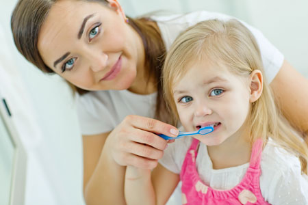 Mom and Daughter brushing their teeth - Pediatric Dentist in Philadelphia and Wynnewood, PA